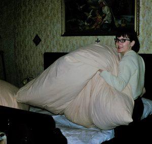 Sharon making bed over corn husk mattrass