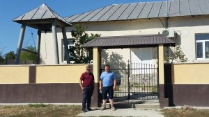 Helmut and Dan Habermann in front of old church in Fachria, Romania