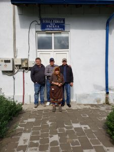 In front of Fachria School, w. resident